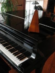 clockwork metronome on piano